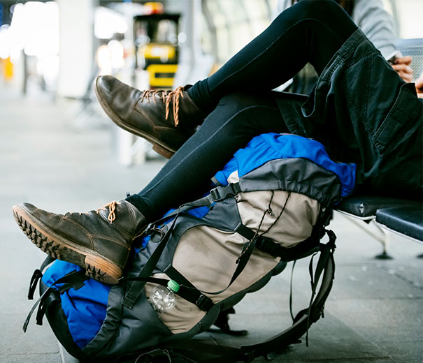 Backpacker waiting for transport while travelling