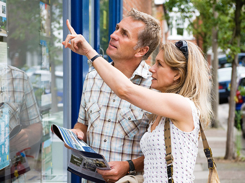 couple looking at houses for sale
