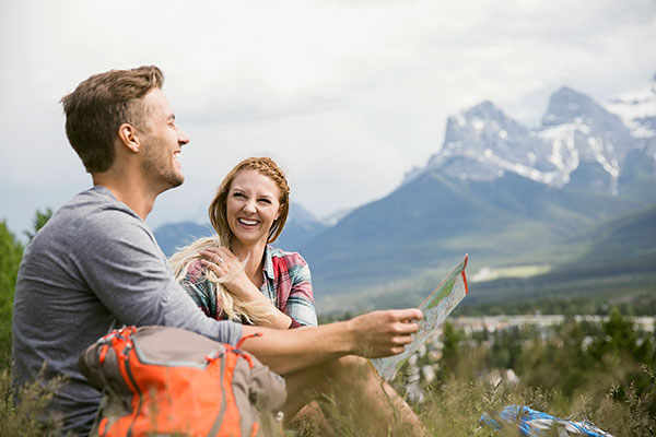 couple reading a map in Canadian mountains