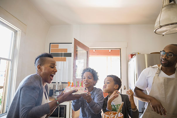 family celebrating cake