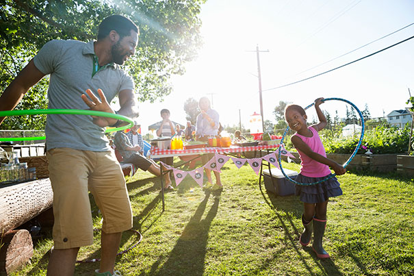 father and daughter hula hooping