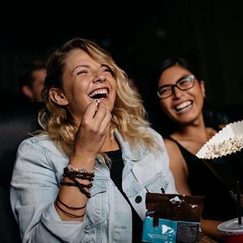 girls enjoying cinema trip