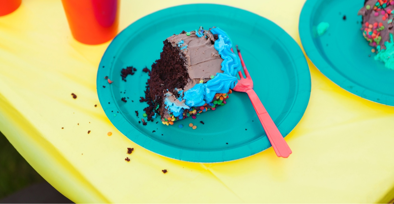 slice of choclate sponge cake with blue frosting;