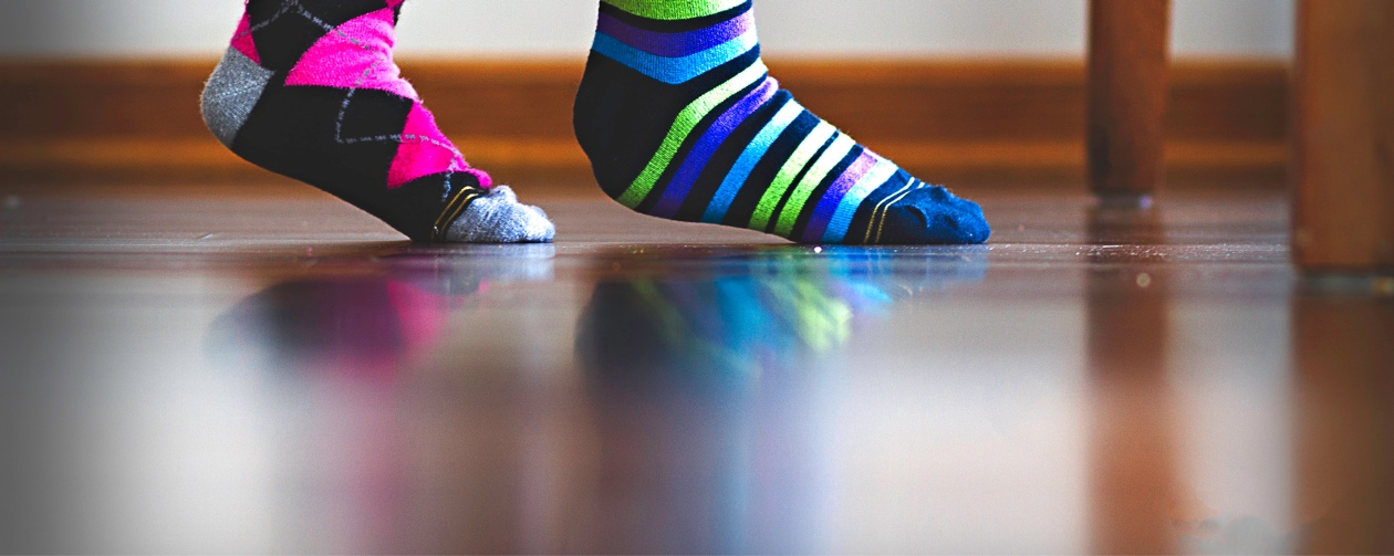 pair of feet in mismatching  socks