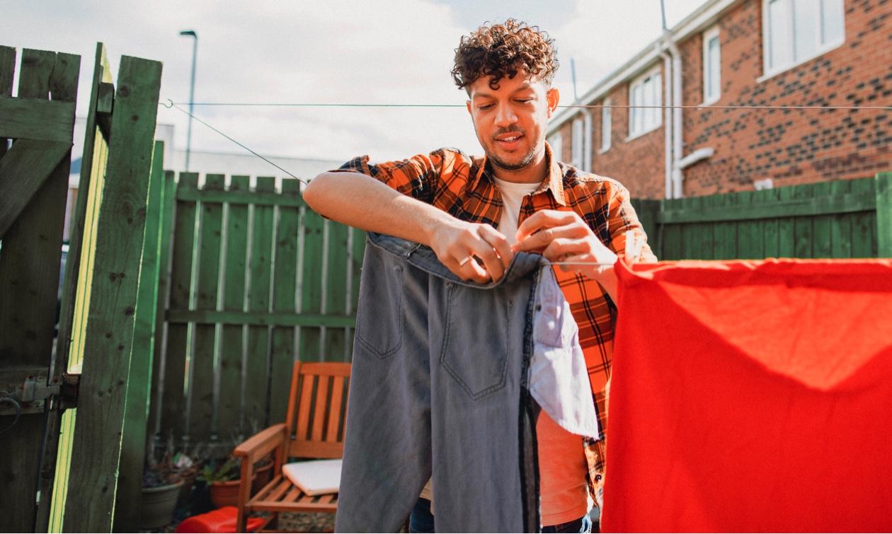 man hanging washing out washing