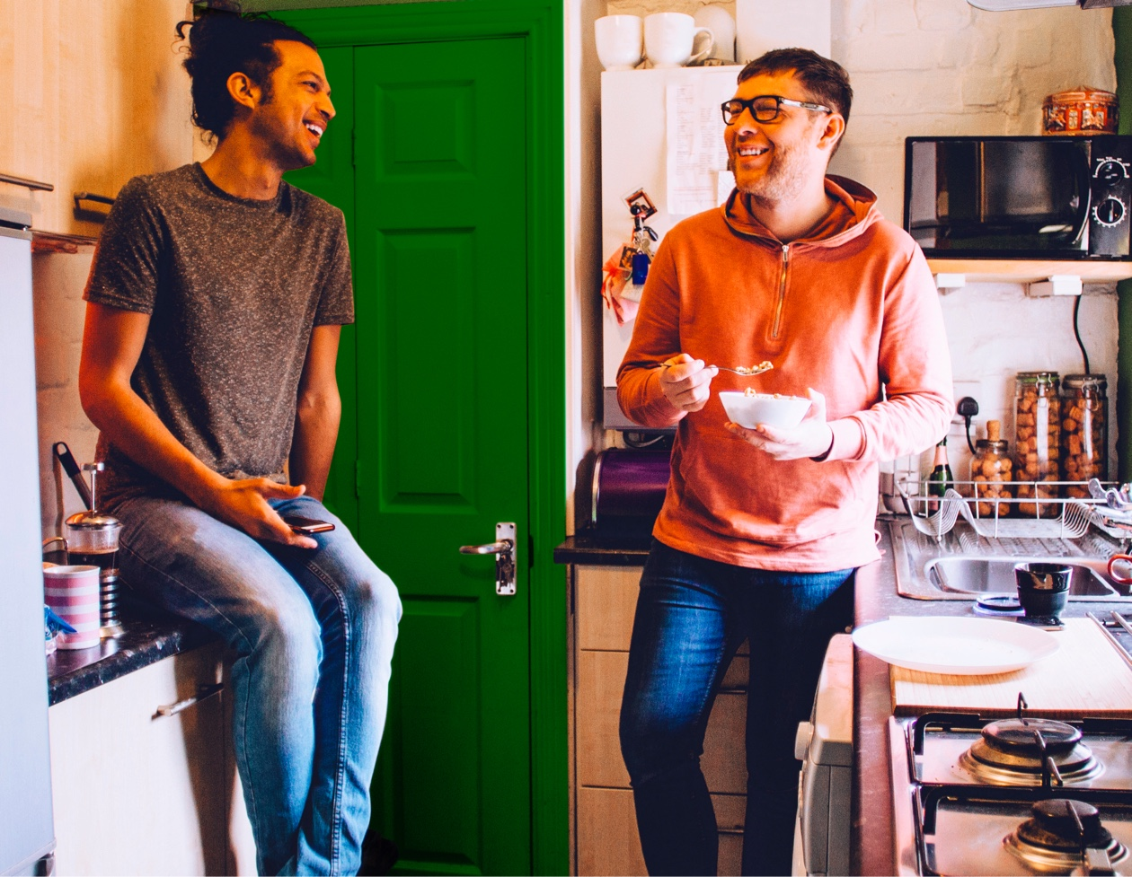 couple laughing in kitchen
