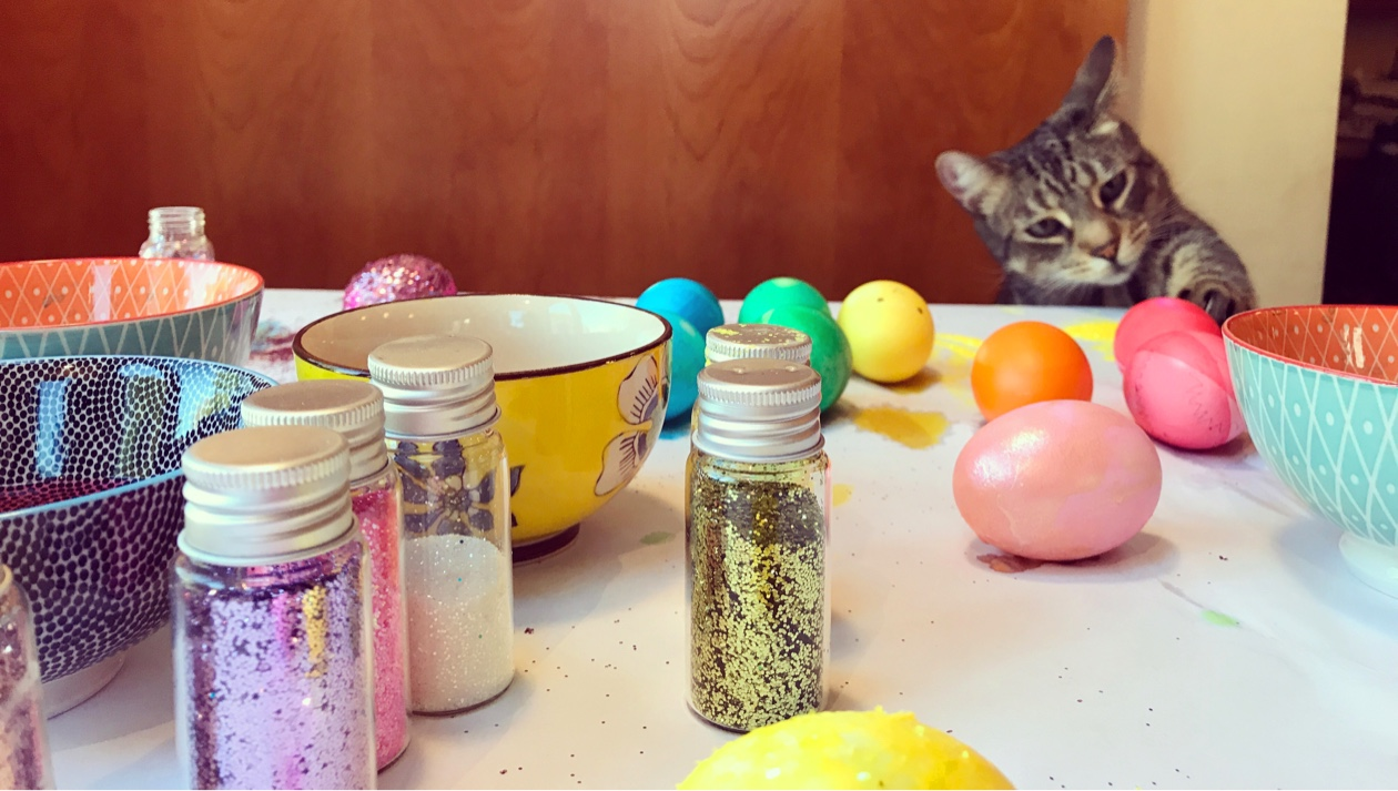arts and crafts table with cat in background