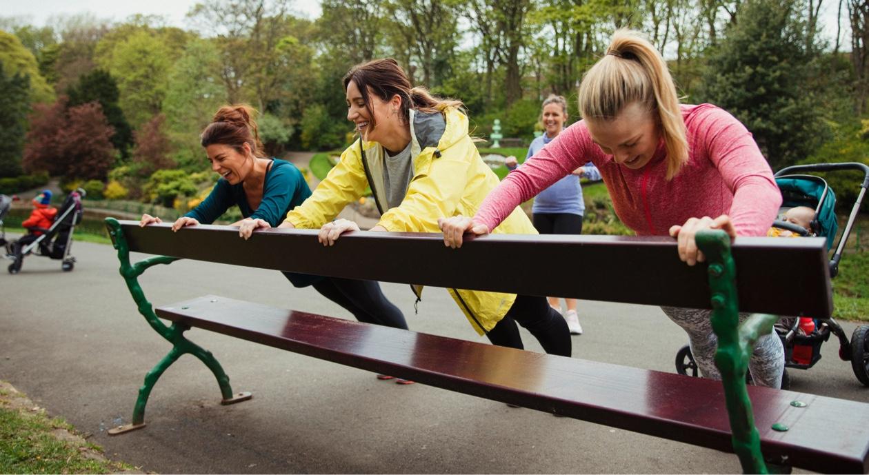 ladies stretching at park bench