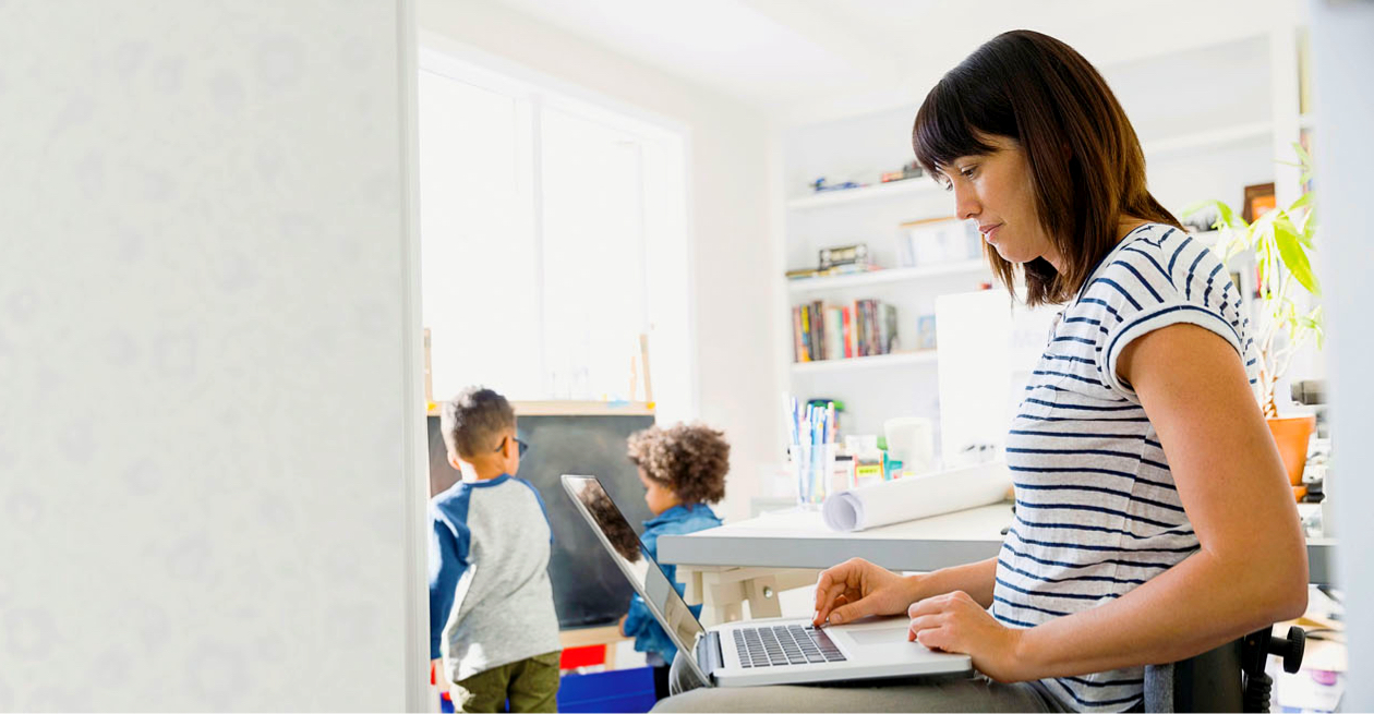 Woman checking her laptop at home