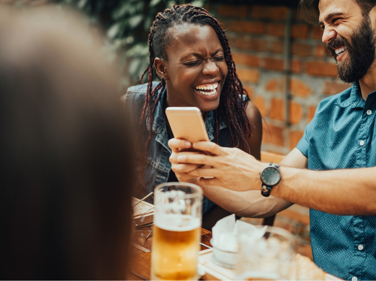 People laughing and drinking in a pub