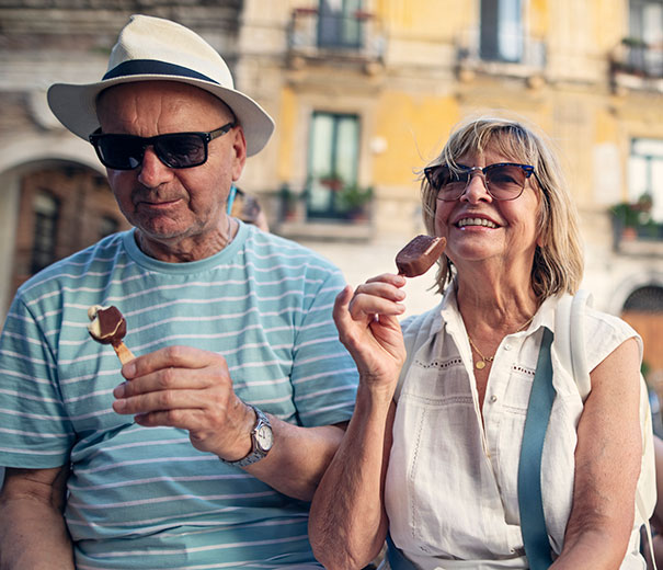 A man and a woman eating ice creams