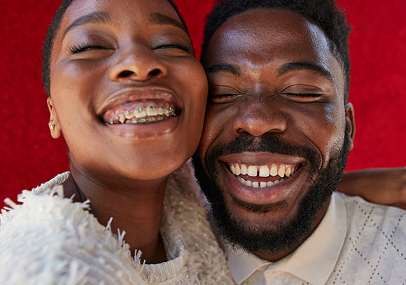 man and woman with big smiles