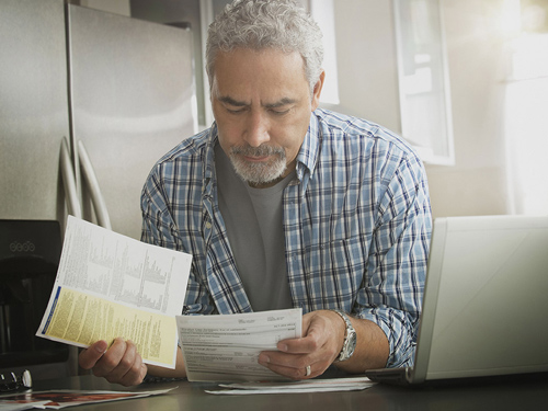 man looking at mortgage documents