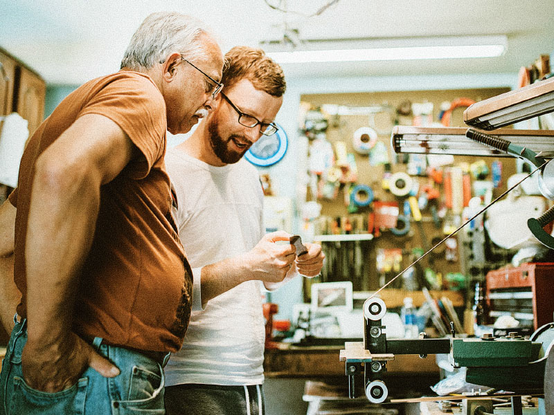 Dad and son at a hardware store.