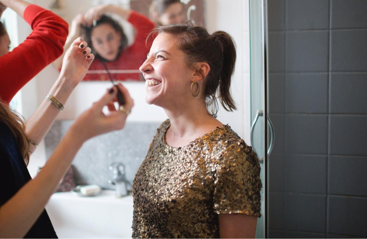 girl doing makeup in bathroom