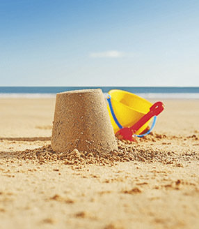 sandcastle with bucket and spade