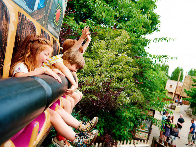 Children on theme park ride